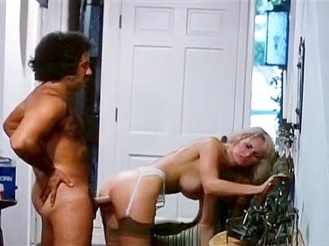 Chick strips and gives her hot ass to Ron Jeremy